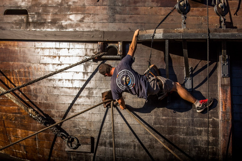 A crew member pulls ropes to help tie the Spanish vessel El Galeon to the Maine Wharf on Tuesday evening.