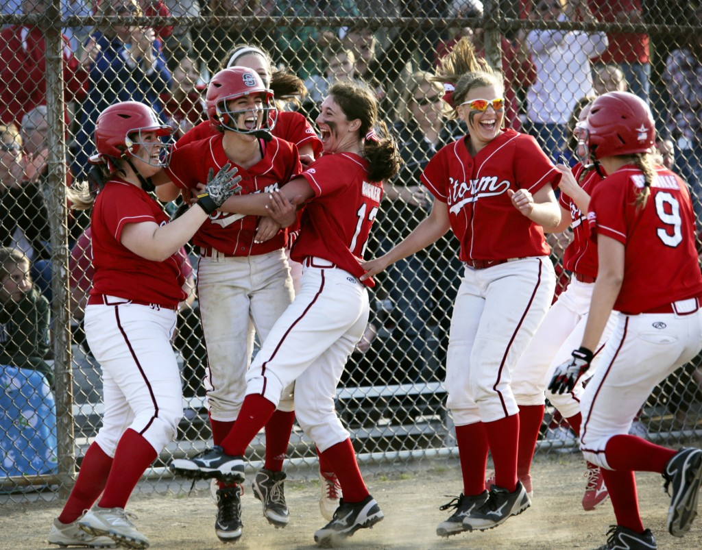 Scarborough teammates celebrate after a walk-off hit by Kaleigh Scoville,  right, that gave the Red Storm a 4-3 win over Biddeford. Derek Davis/Staff Photographer