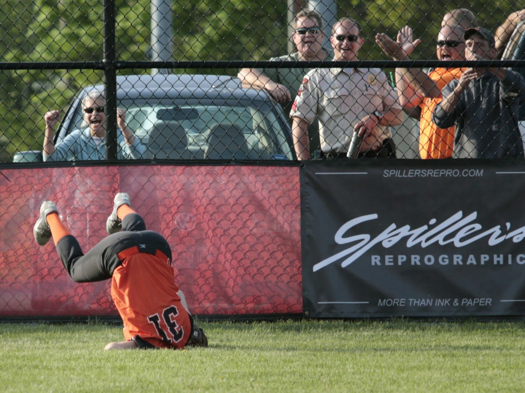 Jocelyn Moody of Biddeford makes a diving catch in center field during the 7th inning.  Derek Davis/Staff Photographer