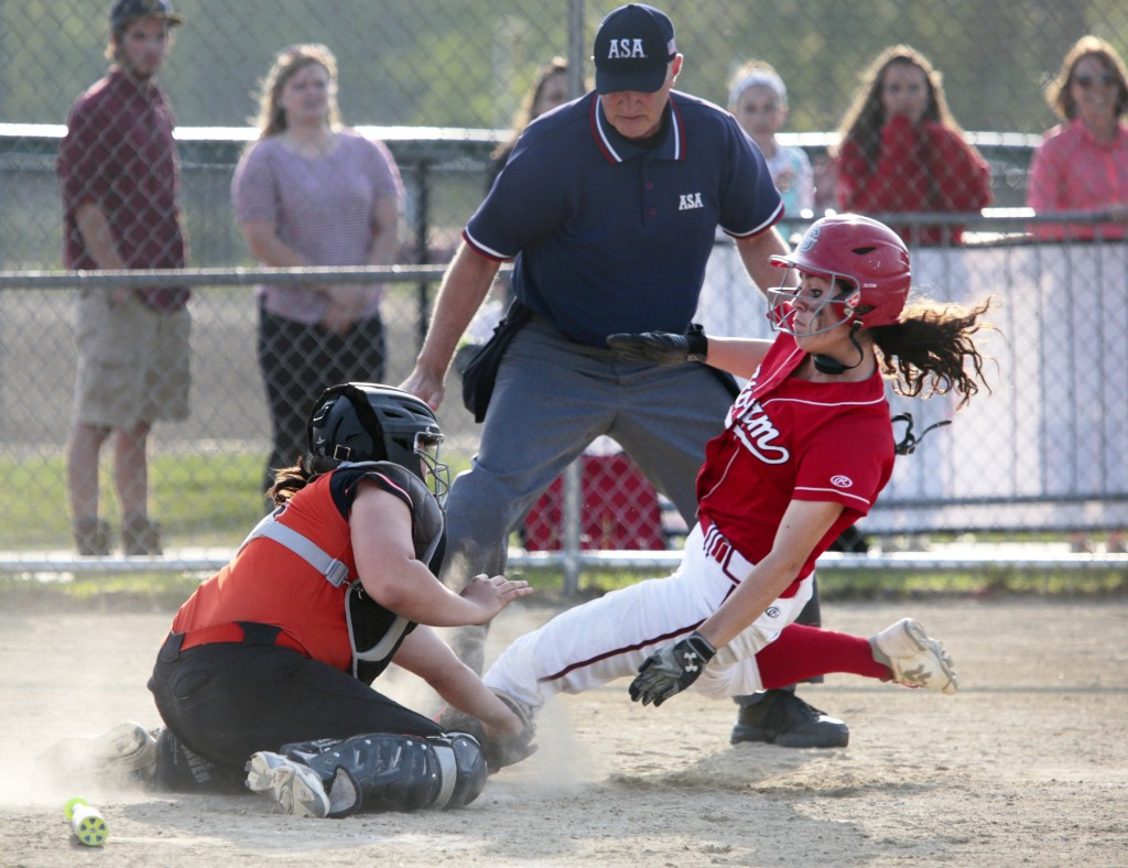 Biddeford catcher Brook Davis tags out Chloe Griffin of Scarborough in the sixth inning Friday. Griffin atoned an inning later, driving home the tying run as Scarborough rallied for a 4-3 win. Derek Davis/Staff Photographer