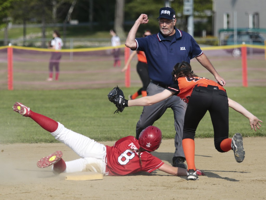 Umpire Jim Tetrault makes the call as Linsdey Kelley of Scarborough is tagged out by Grace Martin of Biddeford while trying to steal in the second inning.  Derek Davis/Staff Photographer
