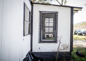 A cat sits in the window of a small trailer in Dixfield. Gabe Souza/Staff Photographer
