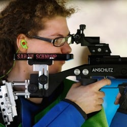 Sarah Schnupp fires an Anschutz air rifle at the Scarborough Fish & Game Association on Wednesday. Schnupp earned an athletic scholarship to the University of the Sciences in Philadelphia to compete on its NCAA Division II riflery team. On Wednesday, she signed her letter of intent and did a shooting demonstration.