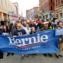 Bernie Sanders supporters march down Congress Street in Portland on Thursday evening, a day before the state Democratic Party Convention.