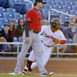 Portland's Aneury Tavarez pops up after sliding into third base with a triple in the second inning Wednesday night at Hadlock Field as  New Hampshire third baseman  Matt Dean watches. John Ewing/Staff Photographer