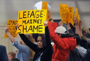 Protesters turned out for Gov. Paul LePage's town hall forum Wednesday in Lewiston. The group was escorted out of the event. Shawn Patrick Ouellette/Staff Photographer