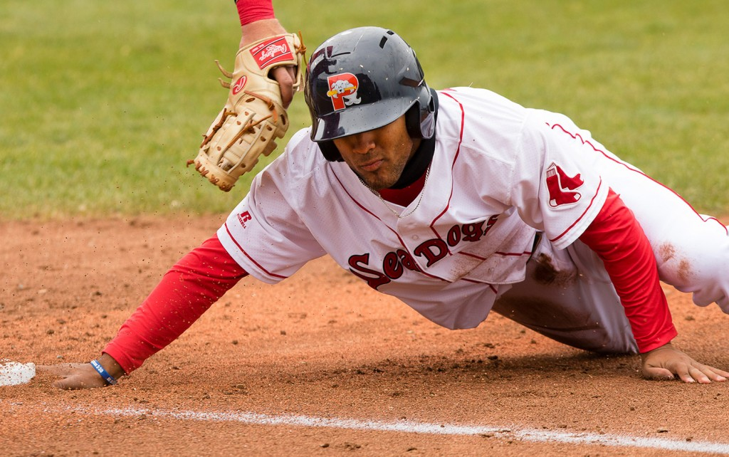 Sea Dogs baserunner Wendell Rijo slides back into first during a pick off attempt. First baseman Rhys Hoskins couldn't handle the throw from pitcher Ricardo Pinto and Rijo advanced to second.