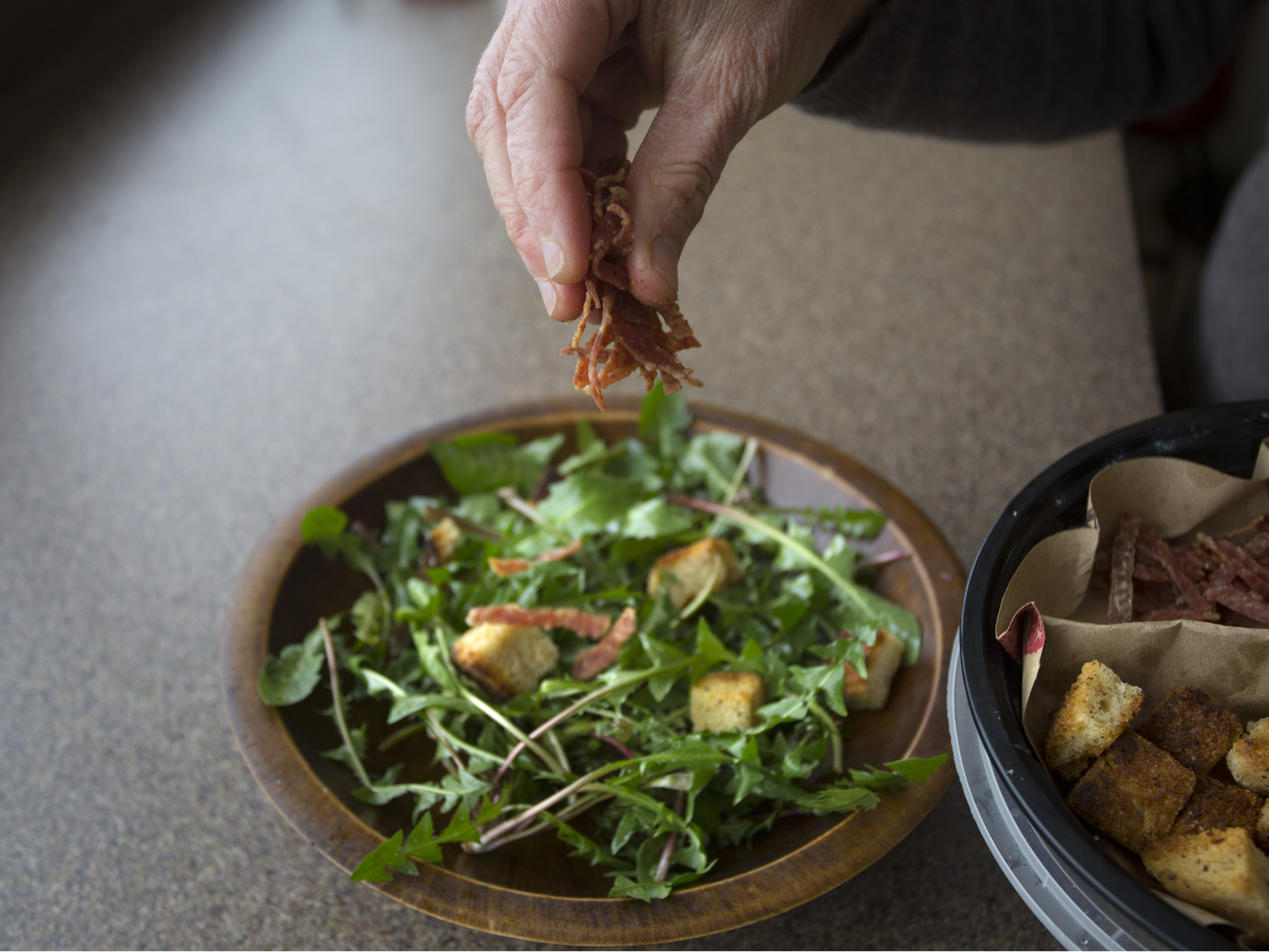 PORTLAND, ME - APRIL 26: Dandelion greens salad. (Photo by Derek Davis/Staff Photographer)