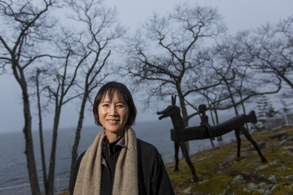 Best-selling author Tess Gerritsen in the backyard of her Camden home, which overlooks Penobscot Bay.