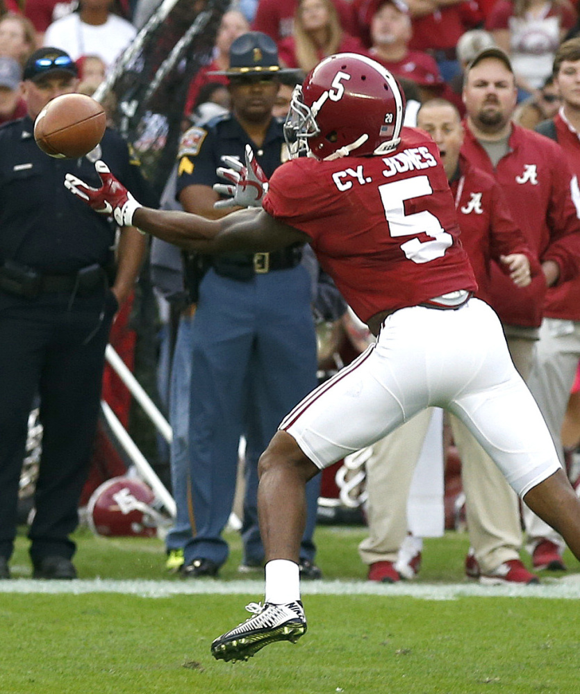 2ND ROUND (60): Alabama defensive back Cyrus Jones intercepts the option pass intended for Charleston Southern running back Ben Robinson in November. The Associated Press
