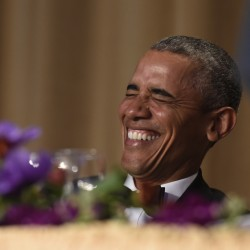 President Obama laughs as he listens to Larry Wilmore, the guest host from Comedy Central, speak at the annual White House Correspondents' Association dinner Saturday. (AP Photo/Susan Walsh)