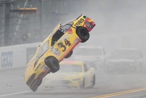 Chris Buescher's car goes airborne during a crash in the Sprint Cup race Sunday at Talladega Superspeedway. The car flipped three times, but Buescher walked away uninjured.