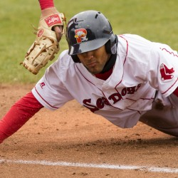 Wendell Rijo slides back into first base on a pickoff attempt Sunday against the  Reading Fightin Phils. Rjio advanced to second on the pla, as first baseman Rhys Hoskins couldn't handle the throw.