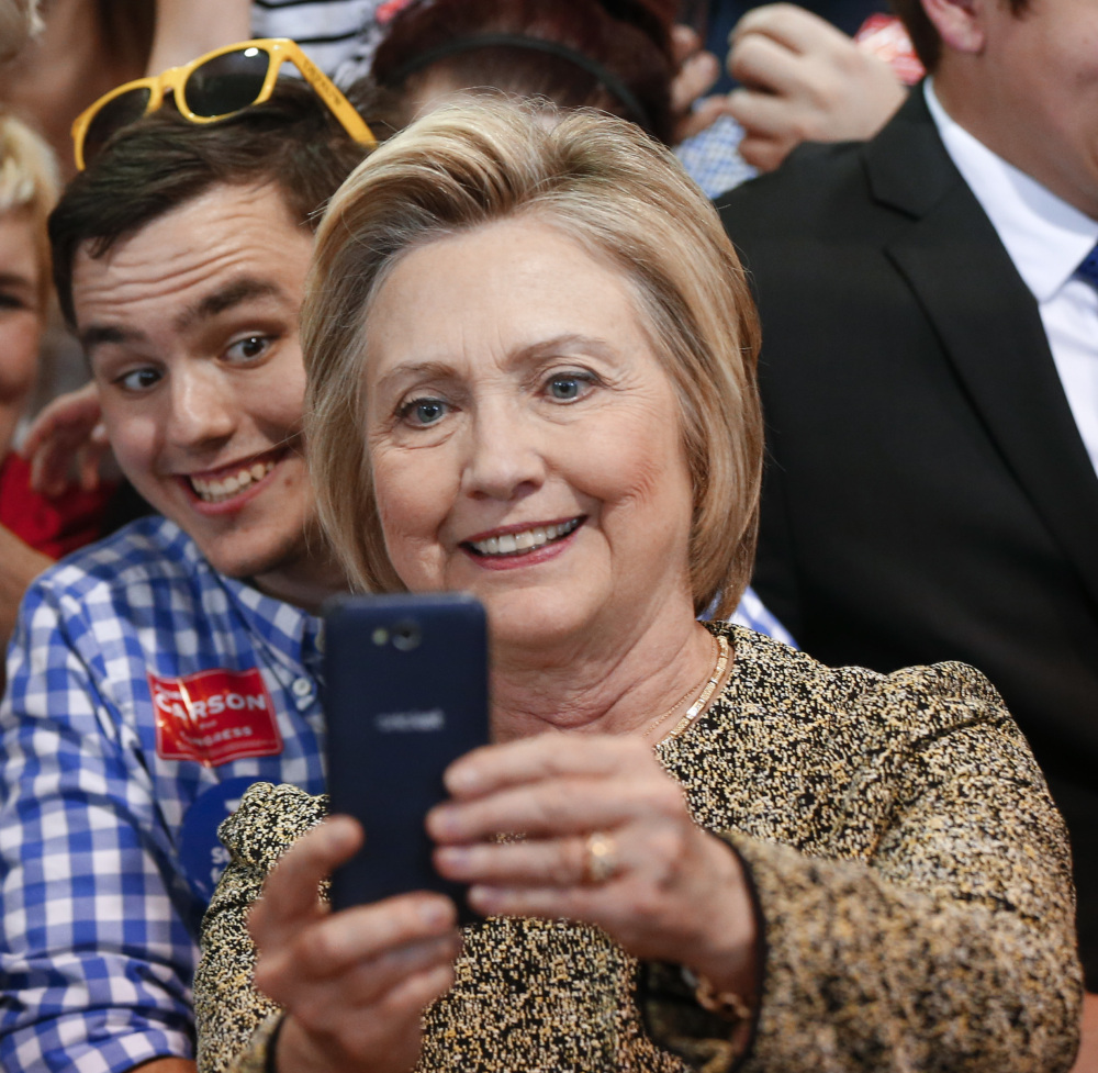 Democratic presidential candidate Hillary Clinton takes photographs with audience members during a campaign stop in Indianapolis, Sunday, May 1, 2016.  (AP Photo/Paul Sancya)