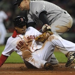 Boston Red Sox right fielder Mookie Betts (50) safely slides into third base as New York Yankees third baseman Chase Headley (12) bobbles the ball during the fourth inning at Fenway Park. Bob DeChiara-USA TODAY Sports