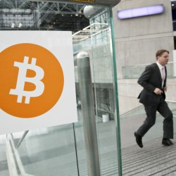 In this April 7, 2014 file photo, a man arrives for the Inside Bitcoins conference and trade show in New York.