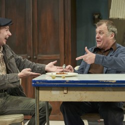 Luigi (Timothy Hassler) and Giovanni (William Zielinksi) share a meal.