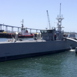 A self-driving, 132-foot military ship sits at a maritime terminal Monday in San Diego. The vessel will be tested for two years to see if it can navigate itself and avoid collisions as it could possibly spend months at a time at sea with no crew aboard.