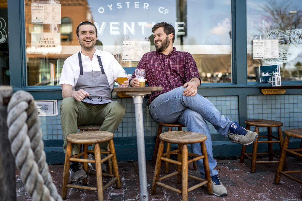 Mike Wiley and Andrew Taylor, shown in 2016 outside their Eventide Oyster Co. on Fore Street in Portland, have won the James Beard Award for Best Chef: Northeast, it was announced Monday.