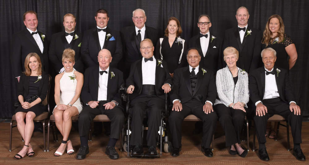 The Maine Sports Hall of Fame held its annual induction ceremony Sunday at Bangor's Cross Insurance Center. The 2016 class includes: Front row, from left to right – Kristin Barry, Sheri Piers, Jack Kelley, Travis Roy, Ralph Payne, Pennie Page Cummings and Ed Phillips; Back row – Royce Cross, Woodrow Cross II and Jonathan Cross of the Cross family, HOF chairman Richard Whitmore, Kirsten Clark-Rickenbach, Dan Hamblett, Doug Friedman and Amy Vachon.