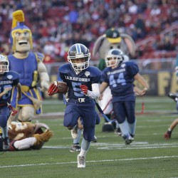 San Jose Marauders youth football players play sports mascots during halftime of an NFL football game between the San Francisco 49ers and the Arizona Cardinals in Santa Clara, Calif., Sunday, Nov. 29, 2015. (AP Photo/Marcio Jose Sanchez)
