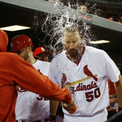 Adam Wainwright of the St. Louis Cardinals is splashed with water by a teammate after hitting a three-run homer during a 10-3 win at Philadelphia on Monday. Wainwright also pitched six strong innings as the Cardinals broke a four-game losing streak.