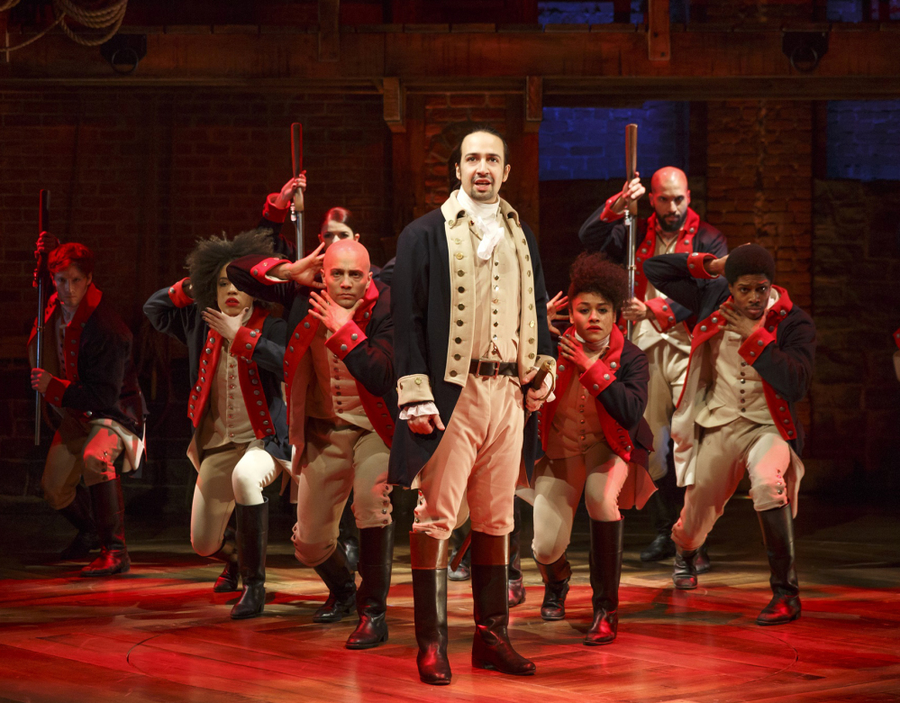"This image released by The Public Theater shows Lin-Manuel Miranda, foreground, with the cast during a performance of ""Hamilton,"" in New York."