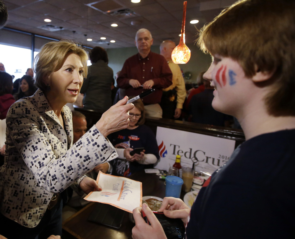 Vice-presidential candidate Carly Fiorina talks with Catrin Moore during a campaign stop at Lincoln Square Pancake House on Tuesday in Westfield, Ind.
