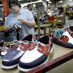 Jewel Rowe hand sews a boat shoe at Rancourt & Co. in Lewiston on Monday. The shoe is identical to those that will be worn by the U.S. Olympic team during opening and closing ceremonies in Brazil.