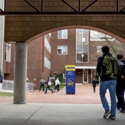 Students change classes near Luther Bonney Hall at the University of Southern Maine in Portland. President Glenn Cummings said USM's financial  turnaround has happened faster than he anticipated.