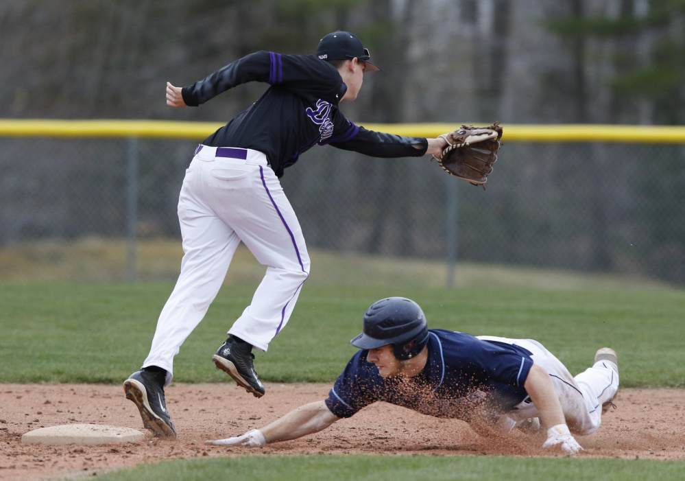 Corey Walker of Westbrook steals second base Tuesday as Mitchell York of Deering attempts to haul in the throw during Deering's 3-2 victory. The Rams improved to 4-1 and dropped the Blue Blazes to 1-3.