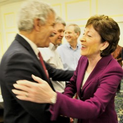 Maine Sen. Roger Katz, R-Augusta, greets U.S. Sen. Susan Collins, R-Maine, on Wednesday at the Kennebec Valley Chamber of Commerce luncheon celebrating women leaders in the region.