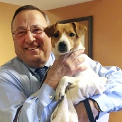 Gov. Paul LePage adopted a dog at the Greater Androscoggin Humane Society, but what was a happy occasion for the governor was heartbreaking for a woman from Mexico, Maine.