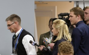 Superintendent Frank Sherburne walks past the media without comment Monday at a school board meeting where he came under fire from residents concerned about his leadership of SAD 6.