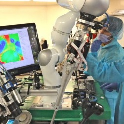 This photo provided by Axel Krieger/Science Translational Medicine shows an autonomous procedure being performed by a robot in testing. The Associated Press