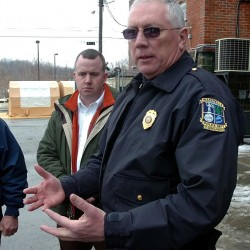Waterville Deputy Chief Charles Rumsey, left, listens as Chief Joseph Massey, right, talks to reporters in 2009 outside City Hall about a suspicious white powder that was mailed to City Hall and the Kennebec Valley Community Action Program. After 21 years with the Waterville police and nine as deputy chief, Rumsey is leaving next month to become police chief in Cumberland.