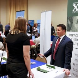 Prospective employers and job seekers meet at a Job Fair in Pittsburgh in March. Weak U.S. economic growth may have made some employers more cautious about hiring in April.