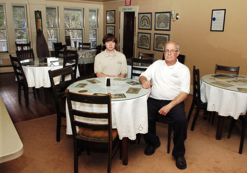 Eric Angevine and his son, Zachary, sit in the dining room of the Sterling Inn in Caratunk. The inn opened in 1816 as a stagecoach stop between Quebec and Boston.