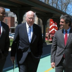 U.S. Transportation Secretary Anthony Foxx, left, Sen. Patrick Leahy, center, and Burlington, Vt., Mayor Miro Weinberger walk outside a rail station in Burlington as they announce Amtrak trains will come back to Vermont's largest city.