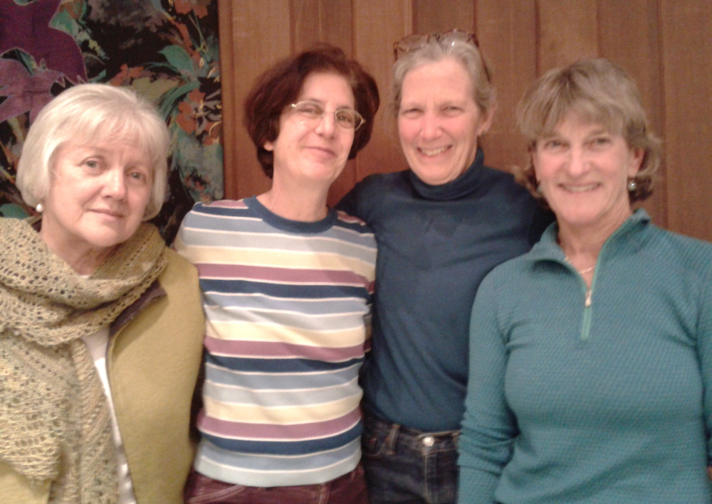 Women in Harmony Grant Team members, from left, Cyrene Slegona, Lisa Derman, Jaki Ellis and Sarah MacColl, celebrate the singing group's award from the Davis Family Foundation to bring music and encouragement to individuals affected by cancer.