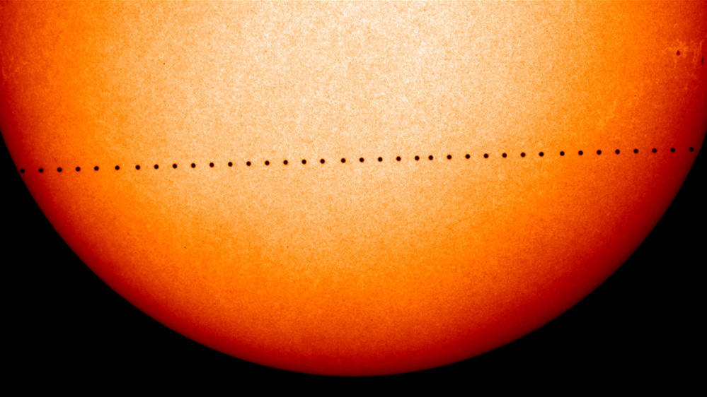 This composite image of observations by NASA and the ESA's Solar and Heliospheric Observatory shows the path of Mercury during its November 2006 transit. On Monday, May 9, 2016, the solar system's smallest, innermost planet will resemble a black dot as it passes in front of the Sun. NASA says the event occurs only about 13 times a century.