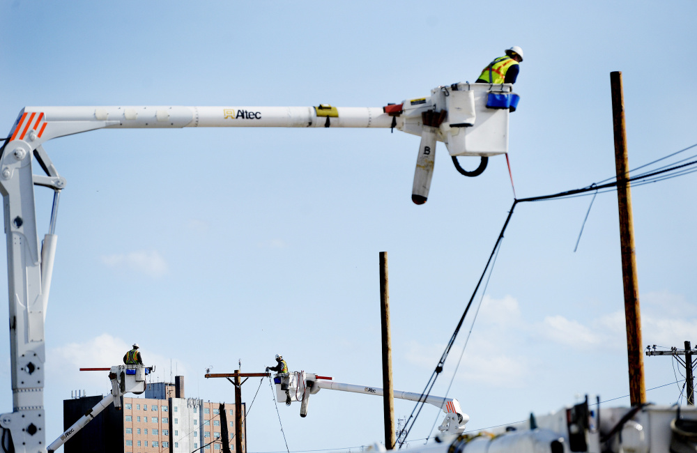 Crews work to restore power on Anderson Street in Portland after a construction accident knocked out power to more than 1,400 homes and businesses Monday.