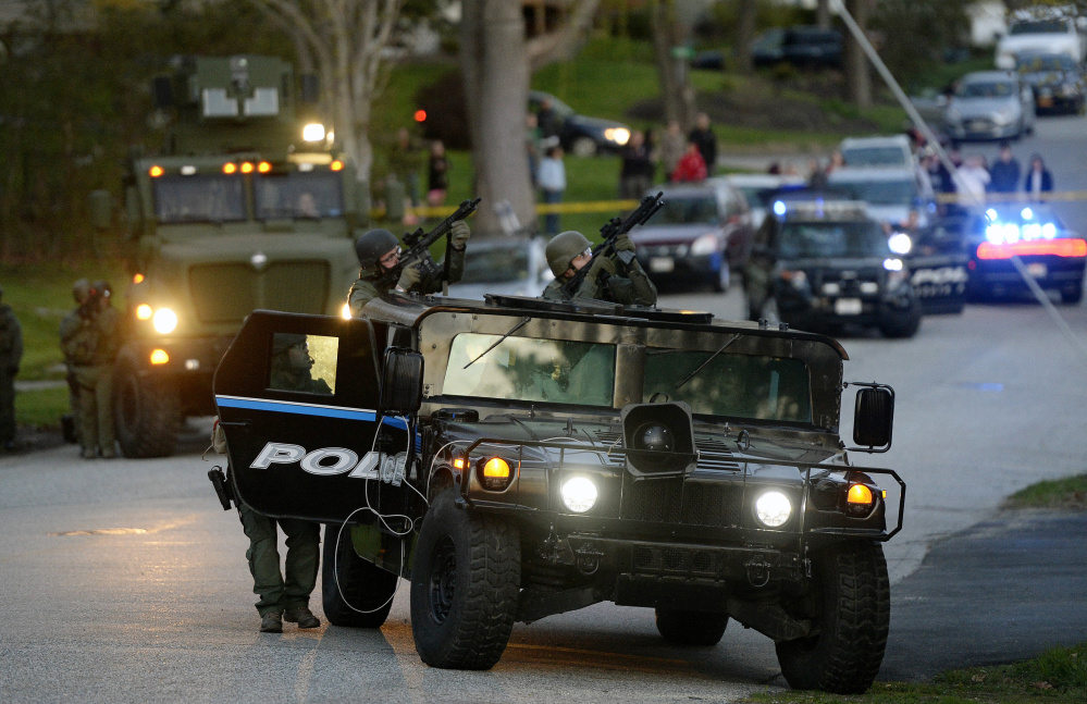 Police approach the apartment building in South Portland where a report of a suicide threat led police to evacuate the residents Monday evening.