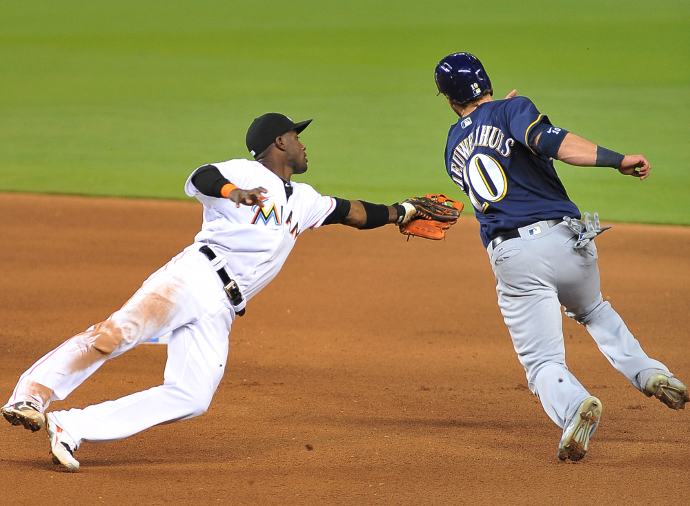 Miami shortstop Adeiny Hechavrria tags out Milwaukee's Kirk Niewenhuis during the fifth inning of a 4-1 win by the Marlins Monday at Miami.