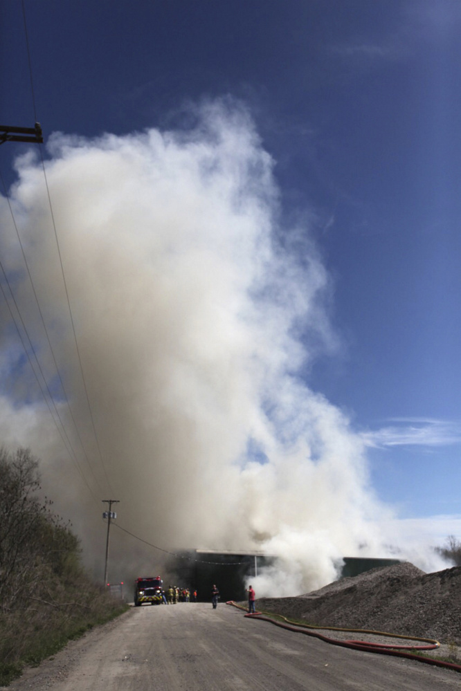 Firefighters from 15 communities fought a fire at Aggregate Recycling Corporation on Route 236, also known as Dow Highway, in Eliot on Tuesday.