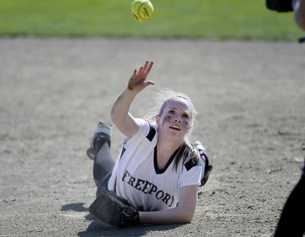 Freeport's Elizabeth Wiest tosses the ball to first base from the ground after making a diving stop on Wednesday against Gray-New Gloucester. The Patriots went on to a 10-0 win.