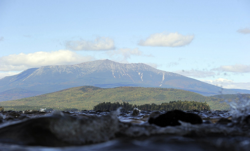 Mount Katahdin in Baxter State Park looms over Lake Millinocket. Conservationist Roxanne Quimby has offered to donate 87,500 acres east of Baxter to the government for a national park, igniting a public debate.