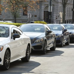 Mercedes C300 coupes line Market Street outside The Press Hotel on Thursday.