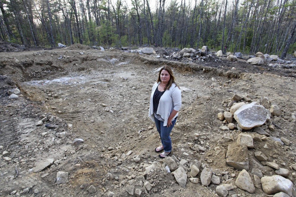 Autumn Poulin paid a $20,000 deposit to Keiser Homes for a modular home she planned in Wells, but the company's bankruptcy leaves her out the money and with a partially dug foundation hole.