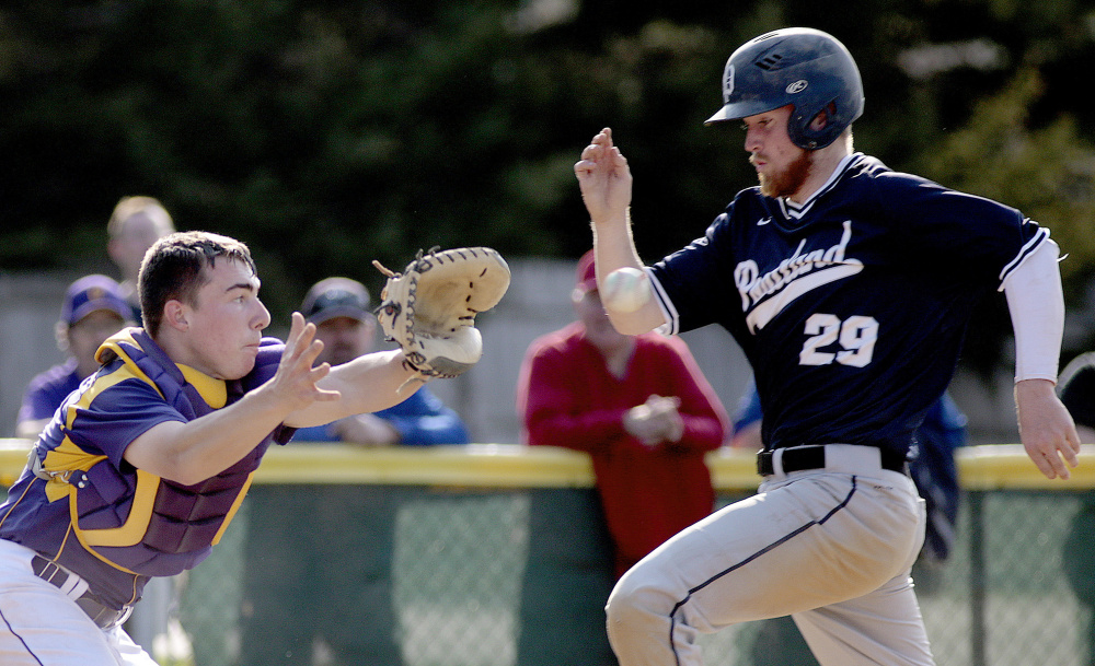 Cheverus catcher Logan McCarthy takes the throw, but too late to get John Williams of Portland, who scored the tying run in the fourth inning Thursday. The Bulldogs scored two more runs in the inning and went on to an 8-1 victory over the Stags.